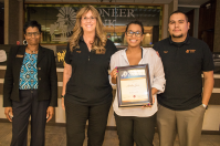 """Carolyn Bell, Denise Wilson and Saul Madrid award Amber Sosa with her Teller II certificate. Saul says of Amber, """"Amber always strives to go above and beyond for our customers and willing to go that extra mile to make sure all their banking needs are met. She always comes in with a smile and ready to give out great customer service."""""""