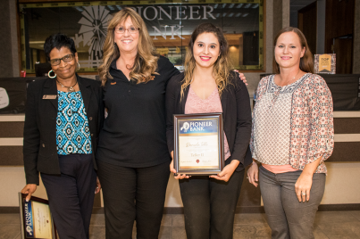Carolyn Bell, Denise Wilson and Jessica Ponce award Daniela Tello with her Teller II certificate