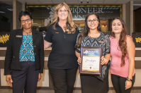 Carolyn Bell, Denise Wilson and Jessica Ponce award Jenae Gayton with her CSR III certificate