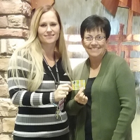 Jessica Ponce, Team Pioneer, presents Donna Eastes of Roswell her gift card