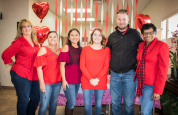 Roswell team members Denise Wilson, Yvonne Aldana, Anna Romero and Carolyn Bell (far right) take a photo with Sarah and Chris Bradley.