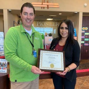 Christopher Palmer, President awards Cristina Carranza with her 5-year certificate.
